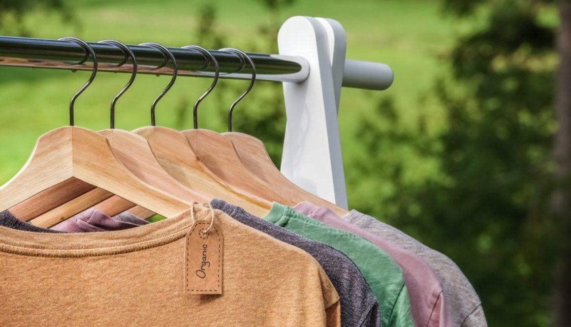 organic-hemp-clothing-shirts-hanging-on-rack-outside