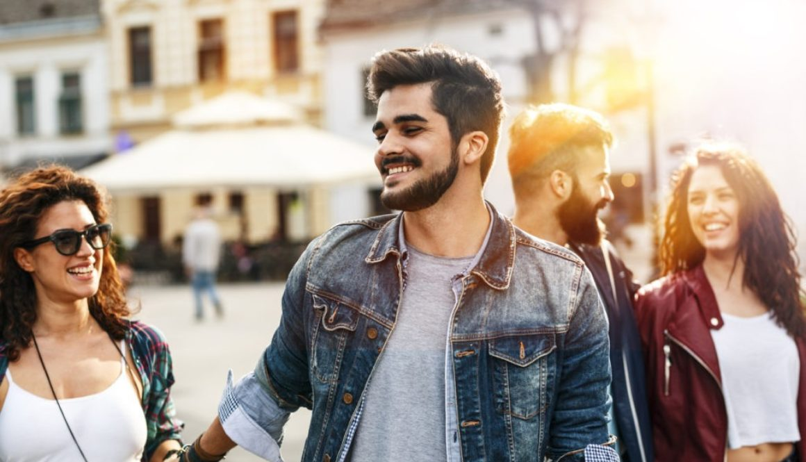 Man who overcame anxiety thanks to CBD walking downtown with his friends