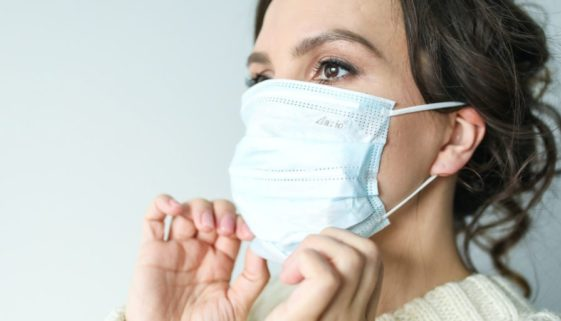 Woman wearing mask during pandemic.